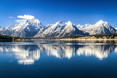 Grand Teton National Park, taken as we were crossing over the Jackson Lake Dam. There was no traffic, so I pulled over on the dam and took the shot.     allformysurvival.com