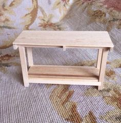 "Mike Botkin Artist Made Handcrafted Counter Bench measures approximately 4 3/4"" Wide, 3"" Tall, and 1 1/2"" Deep, and is constructed of wood by a very talented artisan."