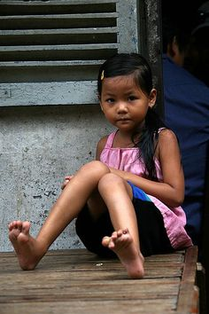 Cute young girl sitting, Phnom Penh, Cambodia