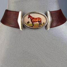 Designer leather choker - prairie horse cameo in sterling silver. Upscale jewelry design.