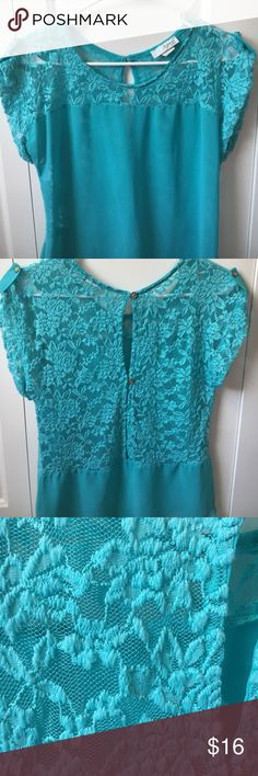 Turquoise top with lace back Only worn a few times, really good condition. Slight pulling of the lace as seen in 4th and 5th pictures, but honestly you could probably get that off if you try.  It's on the collar and a bit in the back. It's not noticeable when worn. It is sheer. The back has gold buttons on it. Bought at a boutique. Also it size, my guess is it would fit a small, maybe a medium Tops Blouses