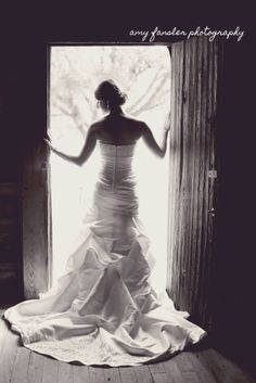 Rustic bridal portrait :: barn :: Classic black and white :: NC Bridal Photography :: back of dress in doorway :: country bridal