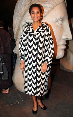 Picking a patterned coat, like Tamu McPherson's, means you can keep everything else on your look minimal. Extend the ladylike theme all the way down to your toes with round-toe low-block courts