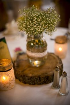 Country Chic Wedding Centerpieces - wood slice under the vase