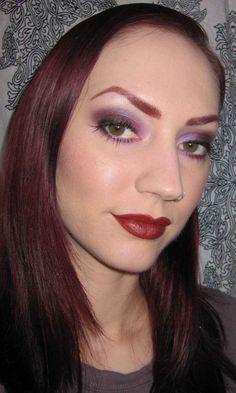 Applying eye makeup ...