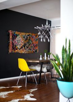 Black feature wall adds depth when combined with bright accents