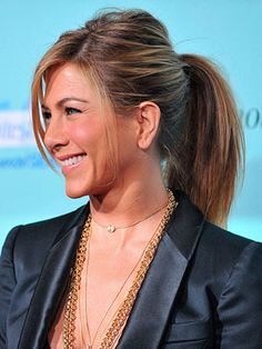 Jennifer Aniston *heat proof summer hair...extra height on the top gives your ponytail a sophisticated feel.  Pull out a few pieces to frame your face.