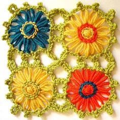 Loomed flowers with a crochet edging then sewn together