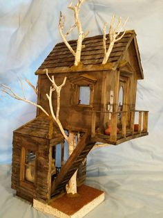 This is the Old Tree House I just created to add to my sales table at the miniature show. I was in such a hurry to build a less expensiv...