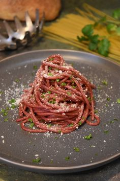 I call this recipe Drunken Spaghetti because the spaghetti is cooked in a bath of red wine,  absorbing the wine and its beautiful color…..making a delicious dish and amazing presentation!