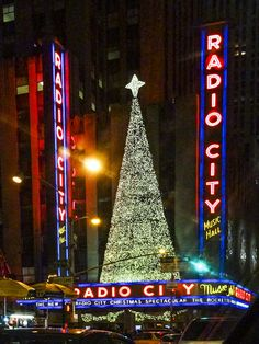 Christmas in New York City I love this photo in New York City with the Christmas tree all lit up between Radio city