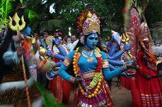 Dancer dressed as a Hindu deity at a festival in Kerala.