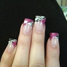 Valentines nails with one all glitter and one zebra stripe with heart in middle