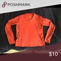 NWOT Nike Women's Long sleeve workout top The picture makes it look Orange but it is definitely a vibrant red. Received as a Christmas gift never wore it because it wasn't quite long enough for me I have a very long torso. Nike Tops Tees - Long Sleeve