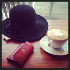 Coffee break #prada #hat #coffee  View more on my blog www.Lionsandwolves.com