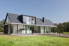 Villa Geldrop is a charming contemporary home in the beautiful style of Hofman Dujardin Architects