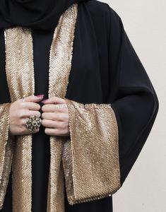 The product of abayas boutique& craftsmanship, it& shaped with front lapels and a wide fold back cuffs. Abaya Fashion, Muslim Fashion, Kimono Fashion, Modest Fashion, Fashion Dresses, Abaya Pattern, Mode Kimono, Modern Abaya, Iranian Women Fashion
