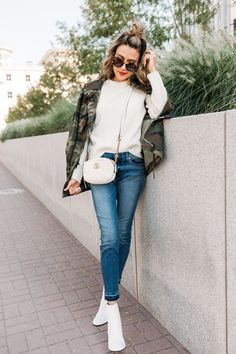 camo jacket and white sweater
