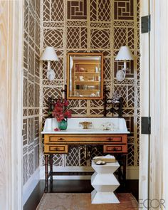 Classical powder room made unique by a sophisticated trellis pattern wallpaper #powderroom #bathroom #interiordesign - More wonders at www.francescocatalano.it