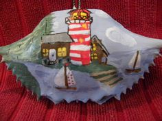 Red and white light house with 2 sailboats and 2 wood houses painted on a Maryland crab shel by Karenscrabs on Etsy
