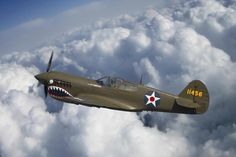Curtiss P-40 Warhawk Flying Tigers Photograph by Adam Romanowicz - The Curtiss P-40 Warhawk is one of my favorite WWII era fighters. Otherwise known as the Flying Tigers, these planes soared through the skies at... BFD