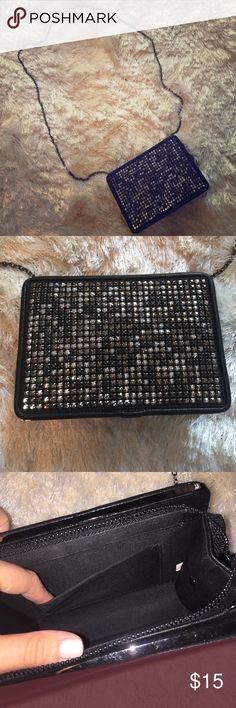 """Black Rhinestone Bag NWOT black with silver accents. Top zipper with one pocket inside. Plain back. Detachable strap. 24 inch strap. Bag measures 7"""" across and 5"""" from top to bottom. **ENTIRE CLOSET BUY 2, GET 1 FREE Bags Shoulder Bags"""