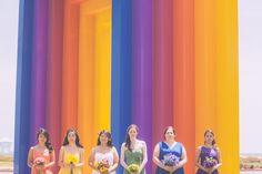 Bridesmaids in rainbow dresses!