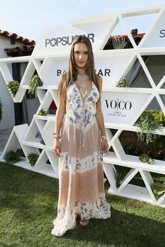 For festival season this year, ditch the cutoffs and opt for a sheer maxi dress like Alessandra.