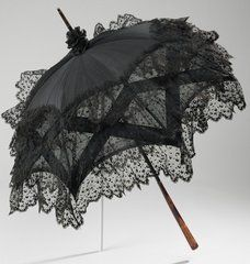 Lovely black parasol...wish they came in diff colors great for sun protection but don't wanna go for the goth look ...at least not all the time;>