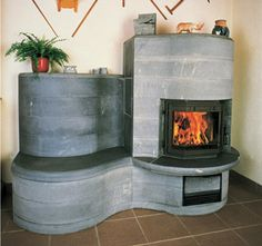 Masonry heater, This is gorgeous! Wonder if my guys could recreate something like this? We have some great business partners that could create a lime-stone cast like this, OH THE IDEAS ARE POURING OUT! ;) gcsmainoffice@gmail.com 303-816-4900