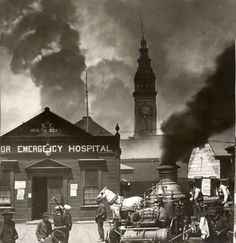 The Great Earthquake and Fire of 1906 in San Francisco, CA. Shows the hospital near the Union Ferry building. You can see smoke from the city in the background.