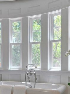 Master Bath: Claw foot tub under triple bay narrow/tall windows-WINDOW OPTION (would be a squared off bay window not curved as in pic)