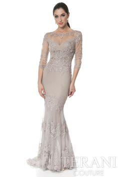 Chiffon evening dress with three-quarter sleeve bodice. This formal gown has a tiered beaded lace skirt.