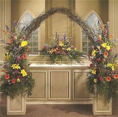 branch wedding decorations | Bring in a garden style look with freestanding urns on either side of ...