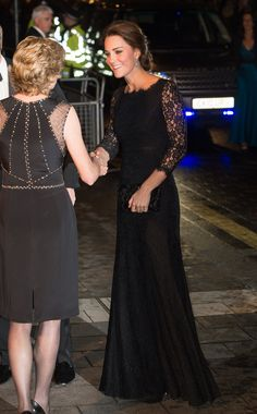 """Kate stepped out with her husband Prince William to enjoy the Royal Variety Show, where One Direction performed. The duchess met band member Harry Styles, who congratulated her: """"I said congratulations on the bump. Though she didn't look bumpy,"""" he said. Kate chose DVF's Zarita Gown ($900), a demure design with intricate lace detail at the neckline, and she accessorized with her go-to glittering night clutch."""