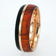 14K Yellow Gold wedding band overlaid with genuine African Blackwood and Amboyna Wood surrounding a 14K Yellow Gold Pinstripe. You can replace the wood w...