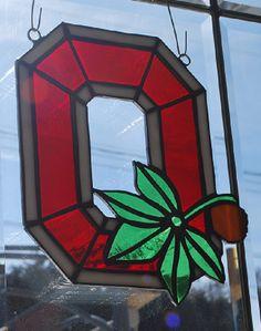 Stained glass Ohio State Buckeye sun catcher/ wall hanging home/ dorm decor by ManemannArt on Etsy https://www.etsy.com/listing/179622483/stained-glass-ohio-state-buckeye-sun