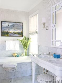 Traditional White Bathroom Designer Lindsey Coral Harper updated fixtures in the master bath of a North Carolina home, added Carrara marble tiles, and had the tub glazed from beige to white. Diy Bathroom Decor, Bathroom Interior, Bathroom Storage, Bathroom Ideas, Bathroom Organization, Bathroom Renovations, Bathroom Tubs, Organization Ideas, Bathroom Stools