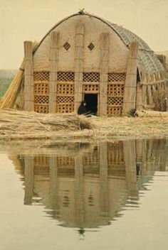 mudhifIraq's 'Garden of Eden'; unique wetlands in southern Iraq where a people known as the Ma'dan, or 'Arabs of the marsh', lived in a Mesopotamian Venice, characterised by beautifully elaborate floating houses made entirely of reeds harvested from the open water.