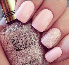 Pink nails with accent glitter nail.