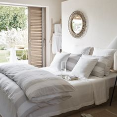 This large-striped bed linen will add a relaxed beach aesthetic to your bedroom. Made in Portugal from cotton sateen, it is washed to reduce shine and create a super-soft feel, while still maintaining the silky drape of sateen. Striped Bedding, Linen Bedding, Bed Linen, White Bedspreads, White Pillows, Cushion Covers, Duvet Covers, Egyptian Cotton Bedding, New England Homes