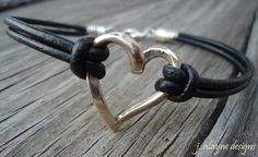 Sterling silver heart with black leather bracelet - $19.50