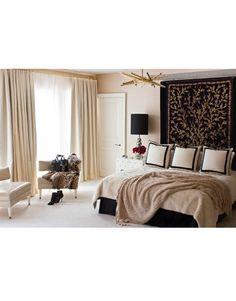 Keeping it neutral in the master bedroom.   - HarpersBAZAAR.com