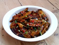 Silky batons of aubergine studded with garlic and smothered in spicy sauce.