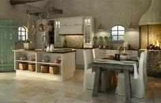 un îlot blanc et en bois dans la cuisine rustique
