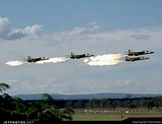 A rare photo of Four RAAF F-111Cs doing a low level formation pass, while doing the famous Dump and Burn. photographed at RAAF Base Amberley (YAMB) in June 1976.