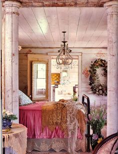 Charming lace bedskirt, wreath, pink, gold...bohemian style. I didn't notice the pillars at first.