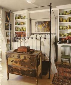 Use the office shelves on either side of guest bed - painted.