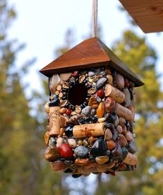 Outdoor hanging Birdhouse with Wine Corks and Rocks. $74.95, via Etsy.  How amazing is this birdhouse!!!  Love the #recycled aspect!!