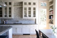 White kitchen with gray countertops and tile.  Open cabinets on top.  This is what I want.